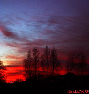 Färgad himmel -Solnedgång